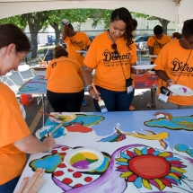 Katherine Weech, Tiffany Lawrence and Chrissie McHenry paint the murals for Bagley Gardens. Tiffany is Director of Human Resources at NeighborWorks America. Chrissie is Senior Vice President of Public Relations at NeighborWorks America.