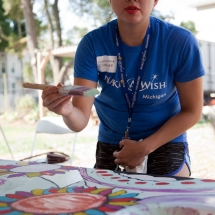 Marianne Elizalde helps paint the murals that she designed and sketched out for the volunteer effort.
