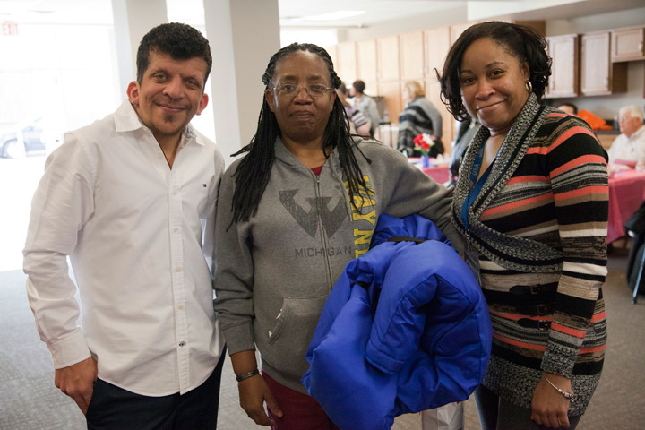 Barbara holds the coat she received made by The Empowerment Plan. With her are Mac Elabed and Claudia Edmonson of Southwest Solutions.